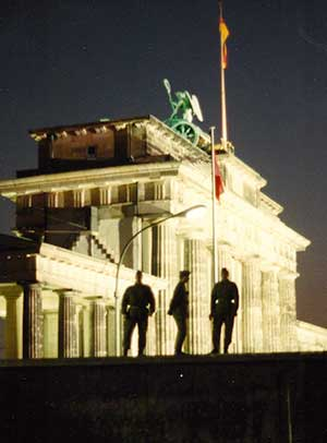 East Germans guards on top of  the Berlin Wall.