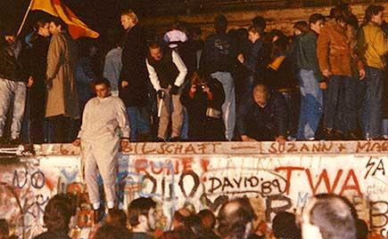 Protestors breach the Berlin Wall in 1989.