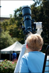 A young scientist learns how to use a telescope at the 2010 UNC Science Expo. (UNC photo)