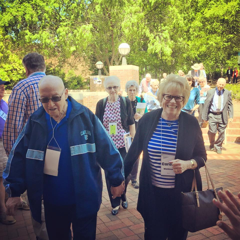 Smiling faces were plenty as alumni arrived for the Old Students Luncheon. (Photo by Austin Root)