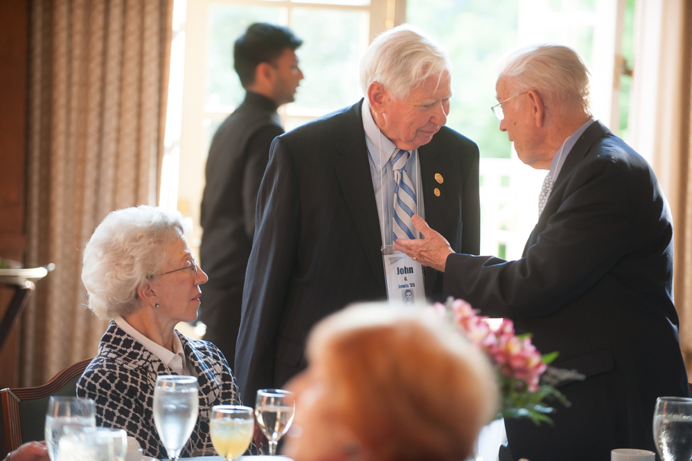 John Lewis chats wtih a classmate at the class of 1955 reunion dinner. (Photo by Shane Snider)