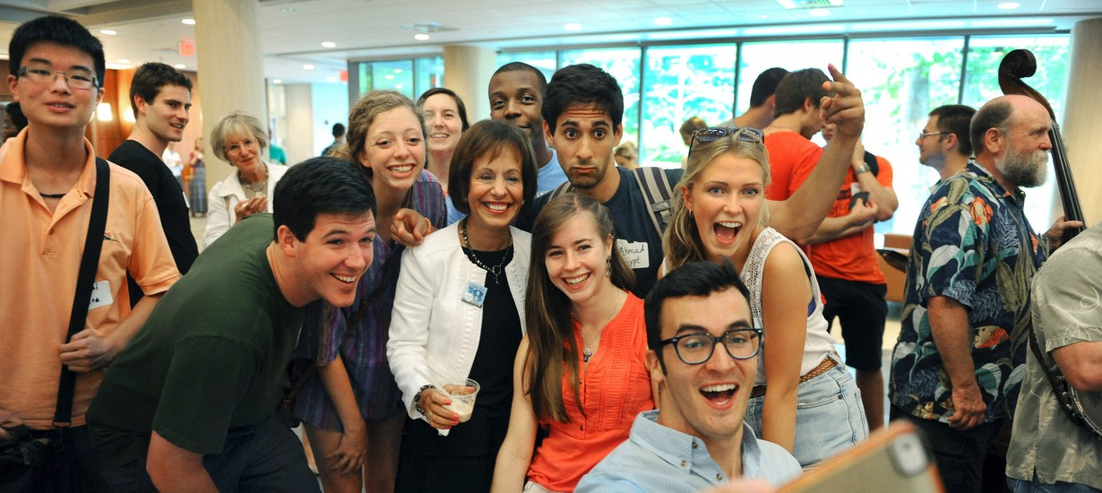 Zack Newbauer '15, after just returning from Australia in 2014, takes a selfie with Chancellor Carol L. Folt and international students and returning UNC study abroad students. (Photo by Donn Young)