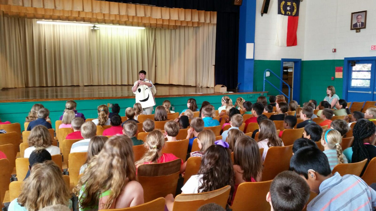 Choquette speaks to students during a visit to an elementary school.