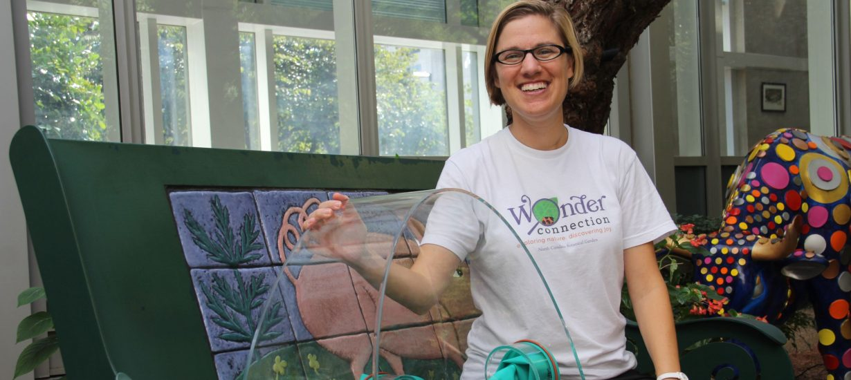 Katie Stoudemire sits in the UNC Children's Hospital atrium with the WonderSphere