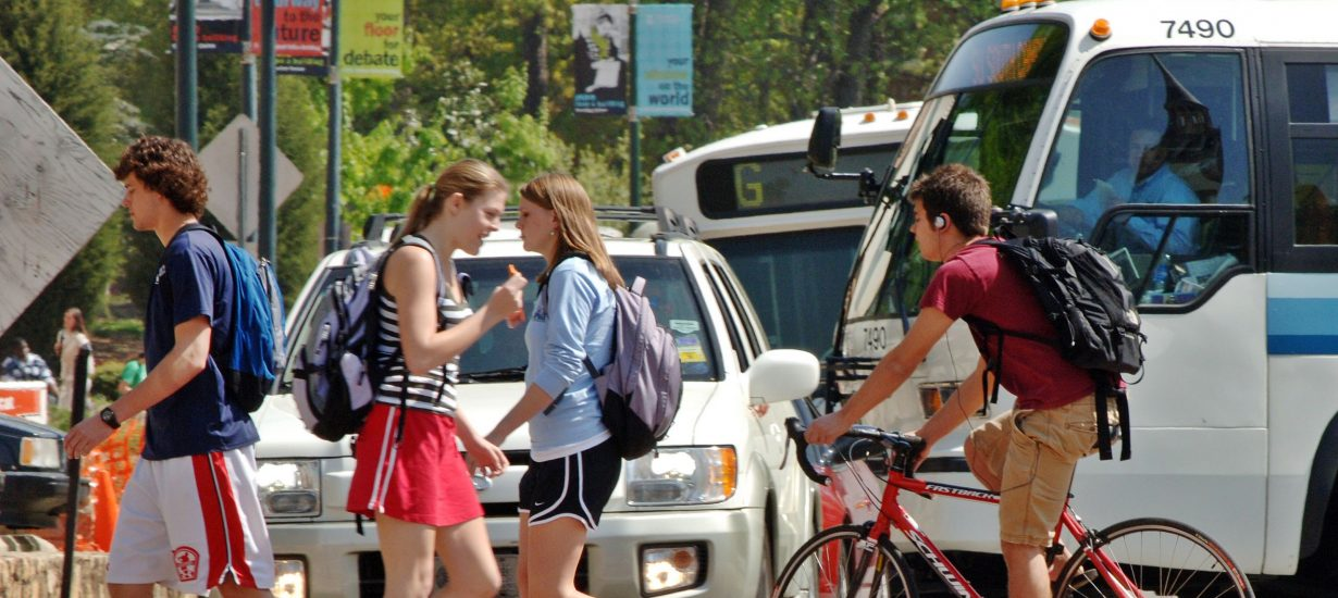 Bicyclists and pedestrians cross South Road at the Bell Tower.