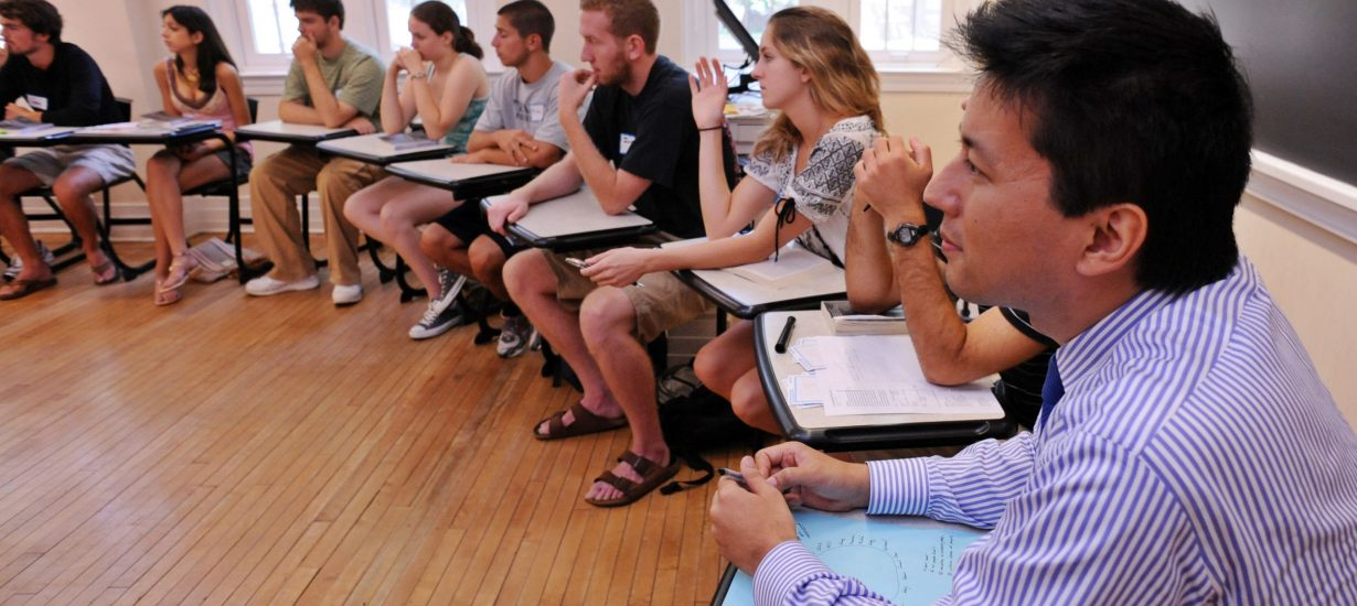 "The Carolina Summer Reading Program, now in its 19th year, aims to stimulate critical thinking outside the classroom and give new students a shared experience. Pictured from 2008 is author Kenji Yoshino, right, listening as first-year students discussed his book, ""Covering: The Hidden Assault on Our Civil Rights."" (UNC photo)"