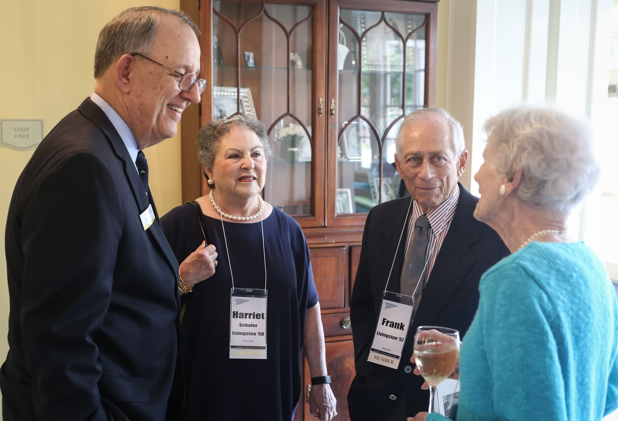 Frank Livingston '57 and his wife, Harriet Schafer Livingston '58, chat with GAA President Doug Dibbert '70 and another guest at the class of '57 reunion. The Livingstons met as students at Carolina. (Photo by Ray Black III)