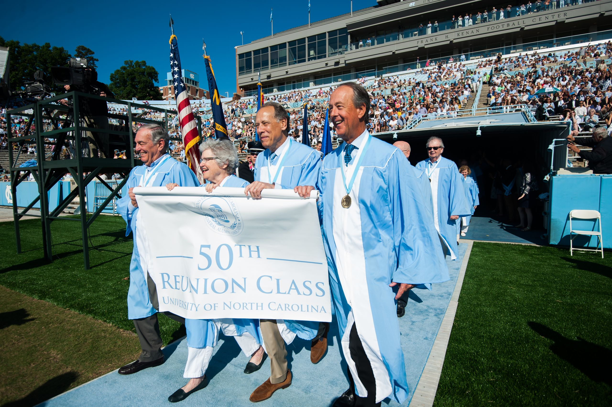 Permanent Class President Jim Brame '67, left, reunion chair Winborne Shaffer Chandler '67, class Vice President Nelson Schwab III '67 and Erskine Bowles '67, former president of the UNC System, lead their classmates in Carolina's Commencement procession. (Photo by Shane Snider)