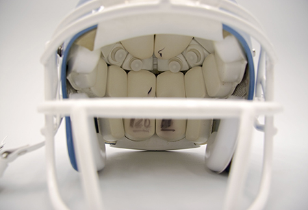 Detail photo of a football helmet.