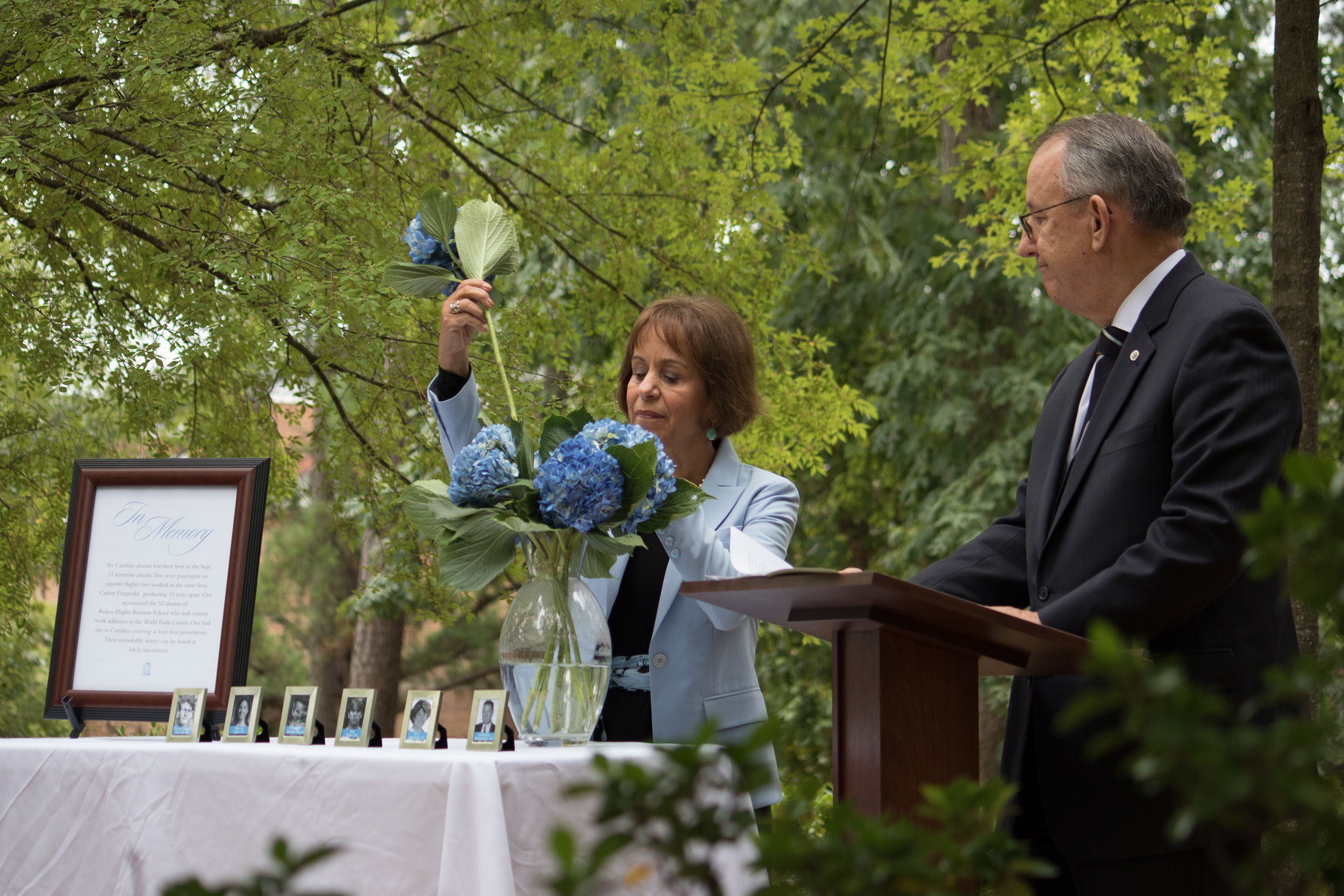 At a solemn ceremony this year at the 9/11 Memorial Garden, GAA President Doug Dibbert '70 read the names of the six alumni, as well as updates on their families today, and Chancellor Carol L. Folt placed a Carolina blue-and-white hydrangea in a vase beside their photos as each name was called. Those present observed a moment of silence afterward. (Photo by Jason D. Smith '94)